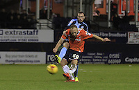 Jake Howells of Luton Town has an effort on goal whilst under pressure from Michael Harriman of Wycombe Wanders during the Sky Bet League 2 match between Luton Town and Wycombe Wanderers at Kenilworth Road, Luton, England on 26 December 2015. Photo by Liam Smith.