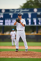 GCL Yankees East relief pitcher Janson Junk (23) looks in for the sign during the first game of a doubleheader against the GCL Yankees West on July 19, 2017 at the Yankees Minor League Complex in Tampa, Florida.  GCL Yankees West defeated the GCL Yankees East 11-2.  (Mike Janes/Four Seam Images)
