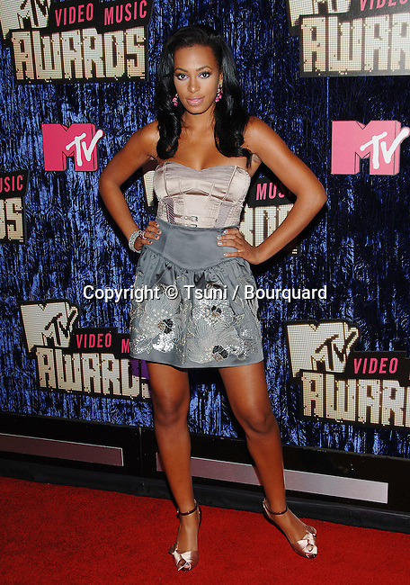Solange Knowles at the MTV vma  Awards at the  at the The Palms Casino Resort in Las Vegas.<br /> <br /> full length<br /> fashion<br /> short skirt blue gray<br /> eye contact