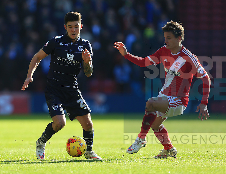 Jelle Vossen of Middlesbrough pressures Alex Mowatt of Leeds - Middlesbrough vs. Leeds United - Skybet Championship - Riverside Stadium - Middlesbrough - 21/02/2015 Pic Philip Oldham/Sportimage