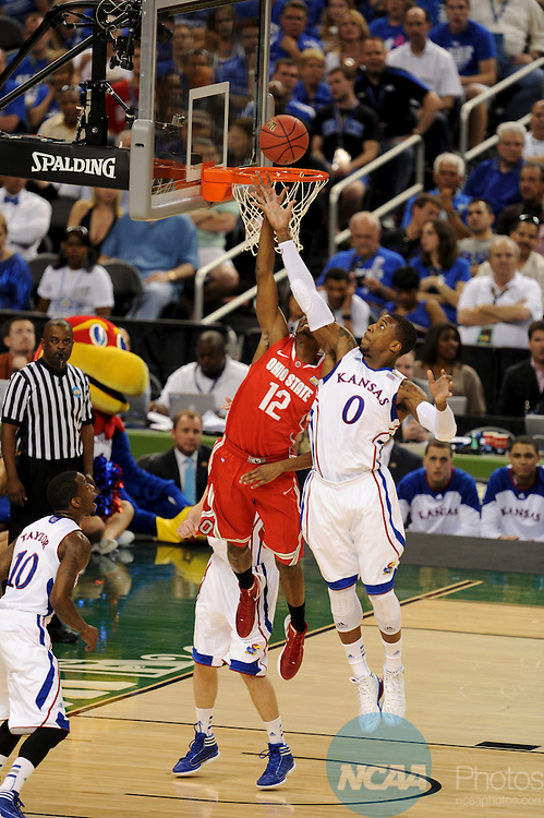 31 MAR 2012:  Thomas Robinson (0) of the University of Kansas lays up the ball over Sam Thompson (12) of the Ohio State University during the Semifinal Game of the 2012 NCAA Men's Division I Basketball Championship Final Four held at the Mercedes-Benz Superdome hosted by Tulane University in New Orleans, LA. Kansas defeated Ohio State 64-62 to advance to the national final. Brett Wilhelm/ NCAA Photos