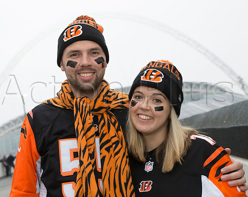 30.10.2016. Wembley Stadium, London, England. NFL International Series. Cincinnati Bengals versus Washington Redskins. Cincinnati Bengals fans dressed in team shirts and with face paint outside the Wembley Stadium with the arch in the background enveloped in London fog before the game.