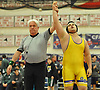 Sam Khondaparast of Oyster Bay raises his arm after his victory at 285 pounds over Mike Spitaletta of Island Trees in the Nassau County Division II varsity wrestling finals at Cold Spring Harbor High School on Saturday, Feb. 10, 2018.