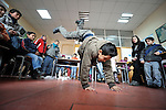 A boy dancing in a class in the Branko Pesic School, an educational center for Roma children and families in Belgrade, Serbia, which is supported by Church World Service. Many of the students' families came to Belgrade as refugees from Kosovo. Many of them lack legal status in Serbia, and thus have difficulty obtaining formal employment and accessing government services.