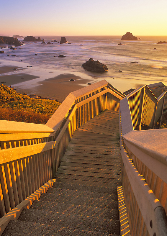 Stairs to beach at Bandon at sunset, Oregon