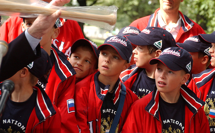 Kozin Alekisey, 12, center, and othr members of the the Russian Youth All-Star Team, wait to receive a new bat that was presented to him by Sen. Jim Bunning and Jack and John Hillerich of Louisville Slugger.  The kids were in the US at the invitation of the Baseball Hall of Fame and have played exhibition games and visit sites such as the White House.