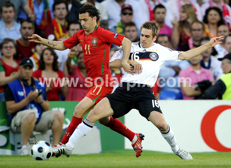 **ALL ROUND PICTURES FROM SOLARPIX.COM**.**SYNDICATION RIGHTS FOR UK AND SPAIN ONLY**.Euro 2008 European Football Championship being held in Austria/Switzerland. Quarter Final, match 25, Portugal vs Germany, at the St. Jakob Park Stadium, Basel, Switzerland. 19th June 2008 ..This pic: Simao and Philipp Lahm..JOB REF: 6690 CPR/Torsten Silz.DATE: 19_06_2008.**MUST CREDIT SOLARPIX.COM OR DOUBLE FEE WILL BE CHARGED* *UNDER NO CIRCUMSTANCES IS THIS IMAGE TO BE REPRODUCED FOR ANY ONLINE EDITION WITHOUT PRIOR PERMISSION*