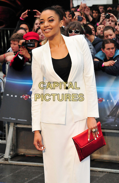 Amal Fashanu<br /> 'Man Of Steel' UK film premiere, Empire cinema, Leicester Square, London, England.<br /> 12th June 2013<br /> half length black top white suit blazer red clutch bag<br /> CAP/BF<br /> &copy;Bob Fidgeon/Capital Pictures