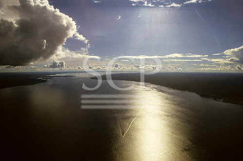 Amazon, Brazil. Aerial view of the mighty Amazon River with the vee of the wake of a riverboat; Para State.