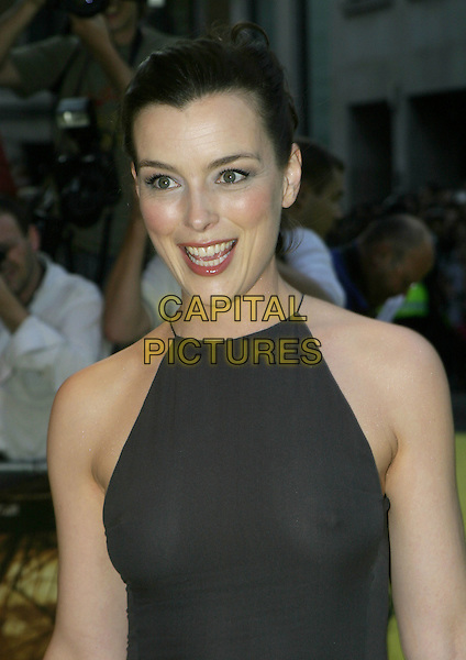 OLIVIA WILLIAMS.UK Premiere of M. Night Shyamalan's The Village at Odeon West End Leicester Square, London W1.August 10th, 2004.headshot, portrait, black halterneck, see through, see thru, nipple.www.capitalpictures.com.sales@capitalpictures.com.© Capital Pictures.