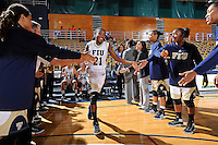 11 November 2011:  FIU's Timeyin Oritsesan (21) is welcomed to the court prior to the game.  The FIU Golden Panthers defeated the Jacksonville University Dolphins, 63-37, at the U.S. Century Bank Arena in Miami, Florida.
