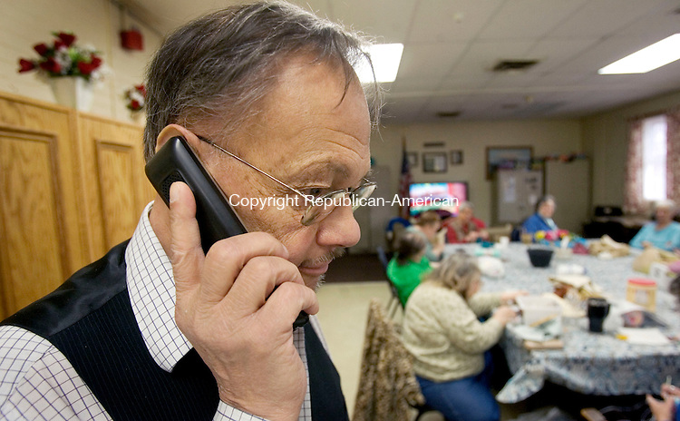 NAUGATUCK, CT. 26 March 2013-032613S04-Richard Wood of Waterbury makes a call at the Senior Center in Naugatuck Tuesday. Seniors were worried landline phones will be a thing of the past. AARP is fighting a piece of legislation that is expected to modernize telecommunications in the state. The giant organization, which represents seniors, says it could be the beginning of end for the landline telephone, a much needed service for seniors..Steven Valenti Republican-American