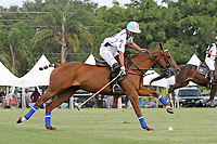 WELLINGTON, FL - APRIL 25:  Adolfo Cambiaso controls the ball along the sideline towards the goal, as Valiente defeats Orchard Hill 13-12, in OT,  in the US Open Polo Championship Final, to win the U. S. Polo Triple Crown, at the International Polo Club Palm Beach, on April 25, 2017 in Wellington, Florida. (Photo by Liz Lamont/Eclipse Sportswire/Getty Images)