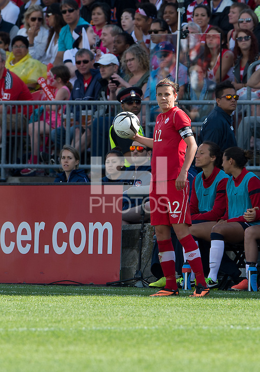 02 June 2013: Canadian National Women's Team forward Christine Sinclair #12 in action during an International Friendly soccer match between the U.S. Women's National Soccer Team and the Canadian Women's National Soccer Team at BMO Field in Toronto, Ontario.<br /> The U.S. Women's National Team Won 3-0.