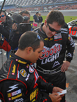 Feb 11, 2007; Daytona, FL, USA; Nascar Nextel Cup driver Juan Pablo Montoya (42) talks with teammate David Stremme (40) during qualifying for the Daytona 500 at Daytona International Speedway. Mandatory Credit: Mark J. Rebilas