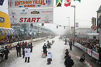 Peter Kaiser leaves the start line during the ceremonial start of the Iditarod sled dog race in downtown Anchorage Saturday, March 2, 2013. ..Photo (C) Jeff Schultz/IditarodPhotos.com  Do not reproduce without permission