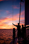 sunset aboard a beneteau 49 sailboat sailing the Charleston South Carolina Harbor during a beautiful night