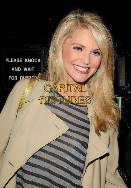 "CHRISTIE BRINKLEY departed after the  evening performance in ""Chicago"", Cambridge theatre, London, England..July 19th, 2011.half length beige mac black grey gray striped stripes top smiling.CAP/CAN.©Can Nguyen/Capital Pictures."