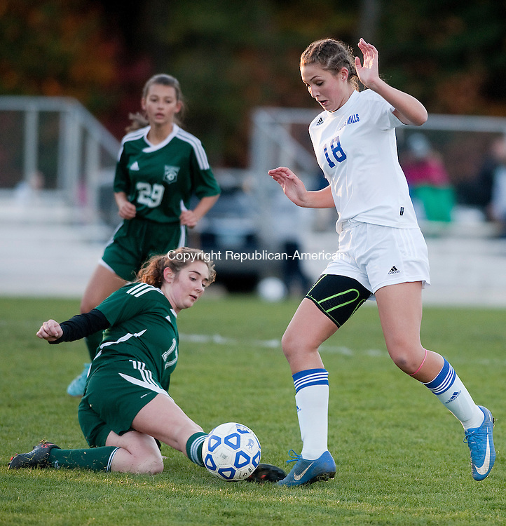 BURLINGTON,  CT-110716JS16-Lewis Mills' Alyssa Wrabel  (18) jusms over a sliding tackle attempt by Griswold's Samantha Casey (17) during their first round Class M tournament game Monday at Nassahegan Field in Burlington. . <br /> Jim Shannon Republican American