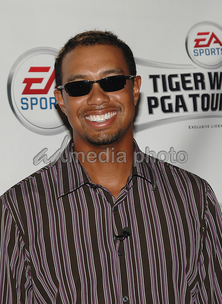 "26 September 2005 - New York, New York - Tiger Woods arrives at the Virgin Megastore in Times Square to promote his new Electronics Arts game, ""Tiger Woods:PGA Tour 2006"". <br />