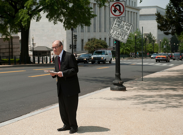 UNITED STATES - MAY 3: Former Fed chairman Alan Greenspan stands outside of the U.S. Capitol on Independence Avenue waiting for his ride on May 3, 2011. (Photo By Bill Clark/Roll Call)