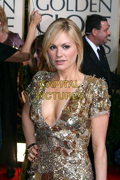 ANNA PAQUIN .Arrivals at the 67th Golden Globe Awards, he Beverly Hilton Hotel, Beverly Hills, California, USA, .January 17th, 2010..globes  half length Stella McCartney dress gold beaded low cut cleavage hand on hip sequined sequin .CAP/AW/MAZ .©Maz/Weber/Capital Pictures.