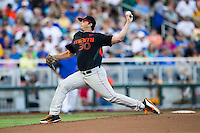 Miami Hurricanes pitcher Andrew Suarez (30) delivers a pitch to the plate against the Florida Gators in the NCAA College World Series on June 13, 2015 at TD Ameritrade Park in Omaha, Nebraska. Florida defeated Miami 15-3. (Andrew Woolley/Four Seam Images)