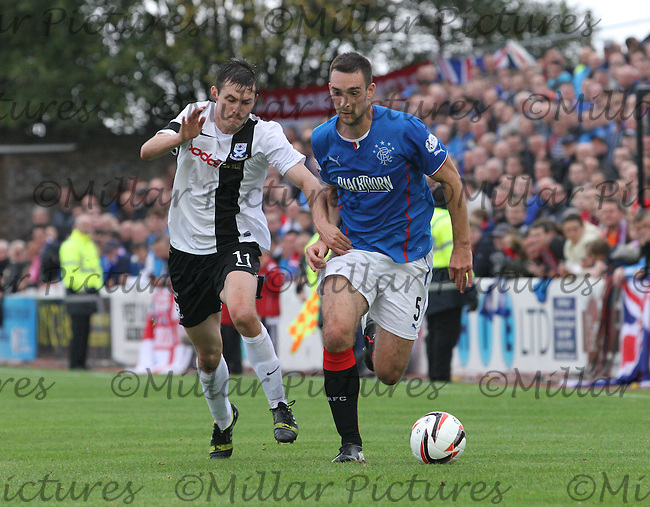 Michael Donald (left) and Lee Wallace  go for the ball in the Ayr United v Rangers Scottish Professional Football League Division One match played at played at Somerset Park, Ayr on 6.10.13.