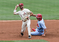 NWA Democrat-Gazette/CHARLIE KAIJO Arkansas Razorbacks infielder Jack Kenley (7) tags out Ole Miss infielder Cole Zabowski (14) during game two of the College Baseball Super Regional, Sunday, June 9, 2019 at Baum-Walker Stadium in Fayetteville. Ole Miss forces a game three with a 13-5 win over the Razorbacks