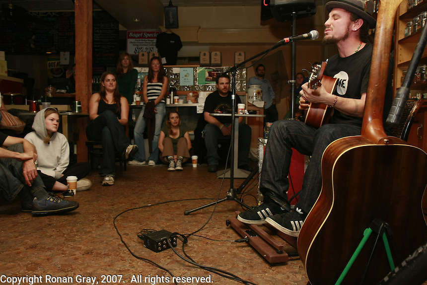 John Butler performs to a full house at an impromptu gig in a small Cafe in Ocean Beach California, November 30 2007.   Butler and Brett Dennen were both supposed to perform after a beach clean-up sponsored by the San Diego CoastKeeper and the local chapter of the Surfrider Foundation.  Heavy rain forced the organizers to cancel the clean-up but Butler and Dennen agreed to play at Newbreak Cafe, a small coffee shop near the beach where the clean-up was supposed to have been held.