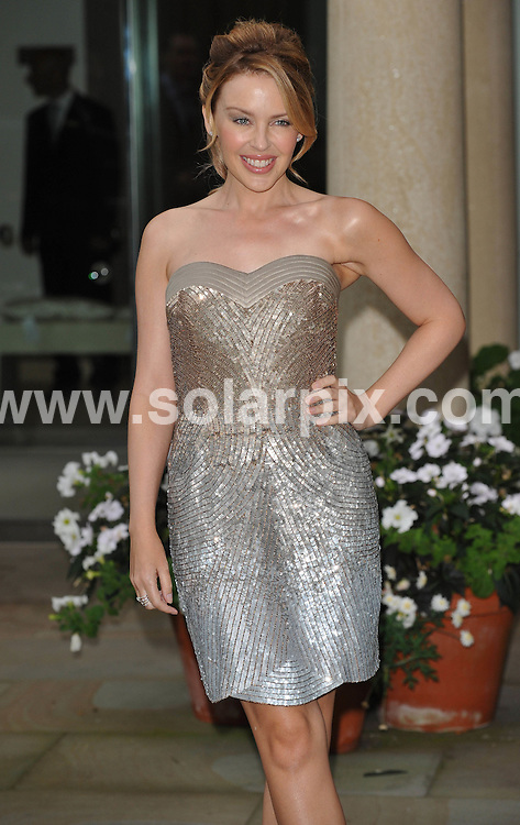 **ALL ROUND PICTURES FROM SOLARPIX.COM**.**WORLDWIDE SYNDICATION RIGHTS**.Kylie Minogue arrives at Ivory Room of The Grove, Herts.   To promote the launch of her new range of bed linen...JOB REF: 9893      SSD     DATE:7.09.09.**MUST CREDIT SOLARPIX.COM OR DOUBLE FEE WILL BE CHARGED**.**MUST NOTIFY SOLARPIX OF ONLINE USAGE**.**CALL US ON: +34 952 811 768 or LOW RATE FROM UK 0844 617 7637**