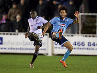 Moses Emmanuel of Bromley and Joshua Gowling of Grimsby Town challenge for the ball during the Vanarama National League match between Bromley and Grimsby Town at Hayes Lane, Bromley, England on 9 February 2016. Photo by Alan  Stanford.