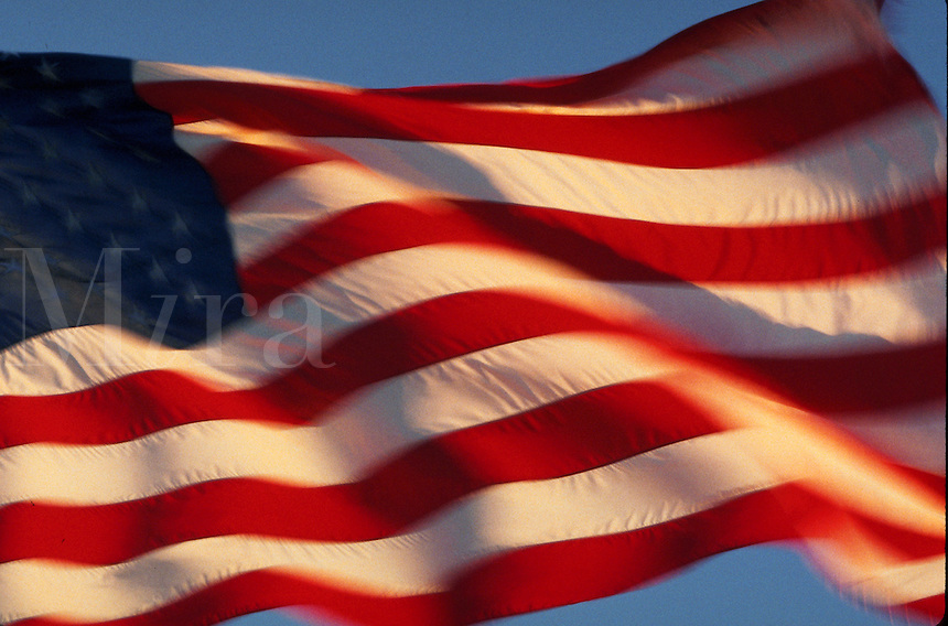 Blurred motion image of an American flag waving in the breeze..