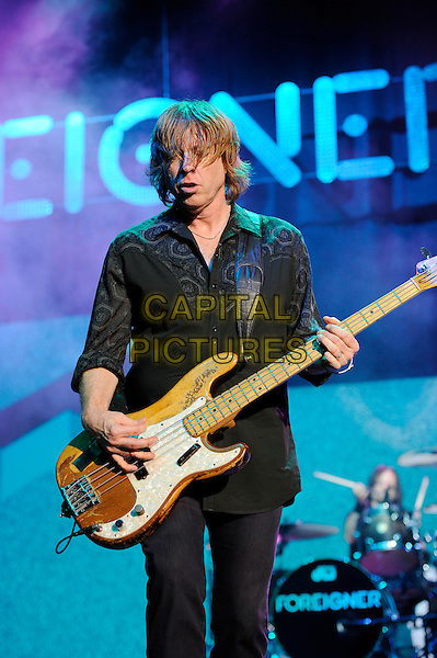 LONDON, ENGLAND - APRIL 13: Jeff Pilson of Foreigner performing at the Eventim Apollo on April 13, 2014 in London, England.<br /> CAP/MAR<br /> &copy; Martin Harris/Capital Pictures