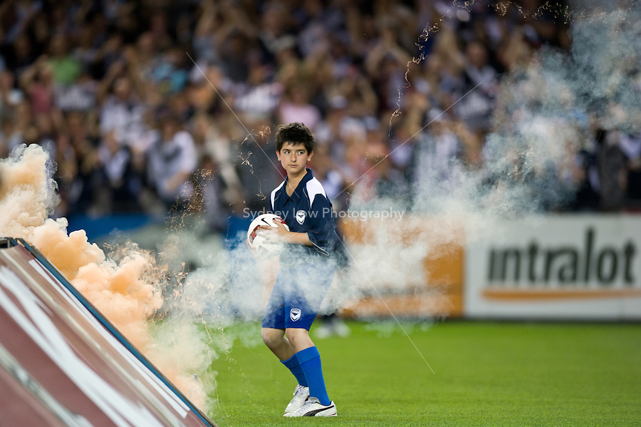 MELBOURNE, AUSTRALIA - OCTOBER 30: Flares thrown onto the field just misses the ball boy during the round 12 A-League match between the Melbourne Victory and Adelaide United at Etihad Stadium on October 30, 2010 in Melbourne, Australia.  (Photo by Sydney Low / Asterisk Images)