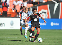 Dejan Jakovic (5) of D.C. United goes against Landon Donovan (10) of the Los Angeles Galaxy.  D.C. United tied the Los Angeles Galaxy 2-2, at RFK Stadium, Saturday September 14 , 2013.