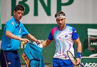 France, Paris, 31.05.2014. Tennis, French Open, Roland Garros, David Ferrer (ESP) receives a towel from a ballboy<br /> Photo:Tennisimages/Henk Koster