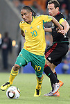 11 JUN 2010: Steven Pienaar (RSA) (10) and Gerardo Torrado (MEX) (right). The South Africa National Team tied the Mexico National Team 1-1 at Soccer City Stadium in Johannesburg, South Africa in the opening match of the 2010 FIFA World Cup.