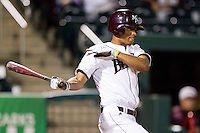 Trey Massenberg (12) of the Missouri State Bears follows through his swing during a game against the Kansas Jayhawks at Hammons Field on March 27, 2012 in Springfield, Missouri. (David Welker/Four Seam Images)