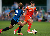 Kansas City, MO - Sunday July 02, 2017: Carli Lloyd attacks the ball upfield pursued by Desiree Scott during a regular season National Women's Soccer League (NWSL) match between FC Kansas City and the Houston Dash at Children's Mercy Victory Field.