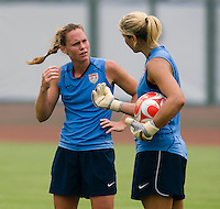 USWNT captain Christie Rampone talks with goalkeeper Hope Solo while practicing at Beijing Normal University in Beijing, China.  The team will now move to Qinhuangdao to prepare for their first two group games of the 2008 Olympics.