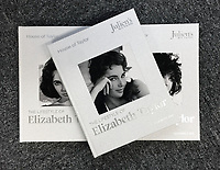 BNPS.co.uk (01202 558833)<br /> Pic: Juliens/BNPS<br /> <br /> The enormous collection covers three albums.<br /> <br /> A spectacular collection of over 1,000 items charting Elizabeth Taylor's life including her iconic outfits are up for sale for over £1million. ($1.25million)<br /> <br /> Dozens of designer gowns, fur coats and capes are being auctioned by the trustees of the estate of the late English actress.<br /> <br /> Also going under the hammer are the Hollywood icon's stylish wigs, scarves, shoes and jewellery.<br /> <br /> Items of her lavish furniture from her luxury homes across the world, right down to her personalised salt and pepper shaker, are included.
