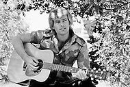"May 1972, Hollywood, Los Angeles, California, USA. American singer and actor Dean Reed, photographed during an outdoor photo session, was unknown in his native country but enjoyed tremendous success in South America, East Germany, and the Soviet Union. He carved out a career acting in spaghetti Westerns but he lamented his anonymity in the USA in a song written for him, ""Nobody Knows Me Back in My Hometown""."
