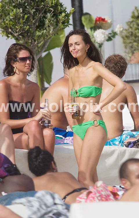 **ALL ROUND PICTURES FROM SOLARPIX.COM**.**WORLDWIDE SYNDICATION RIGHTS**.Hollyaoks star Jennifer Metcalf takes a bank holiday break to the Spanish sun.She met up with Big Brother winner Brian and house mate ziggy.They both took turns in trying to charm her.An lookers commented on how skinny she looked.But she she was tring hard to fatten up with some cold beer..JOB REF:7090          AB1/JS/SF        DATE:22.08.08.**MUST CREDIT SOLARPIX.COM OR DOUBLE FEE WILL BE CHARGED* *UNDER NO CIRCUMSTANCES IS THIS IMAGE TO BE REPRODUCED FOR ANY ONLINE EDITION WITHOUT PRIOR PERMISSION*