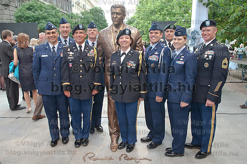 US Army and Air Force and Marine Corps soldiers pose for photographers after the inauguration of the new statue of Ronald Reagan (C) on the square named Freedom in Budapest, Hungary. Wednesday, 29. June 2011. ATTILA VOLGYI
