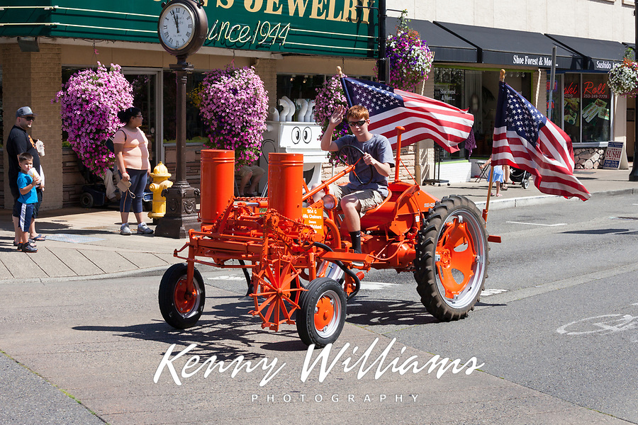 Orange Tractor with American Flags, Auburn Days Parade 2016, Auburn, WA, USA.