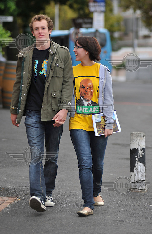 Two young white voters stroll to a polling station near the University of Cape Town on the day of the 2009 general election. She sports a T-shirt supporting African National Congress (ANC) leader Jacob Zuma.