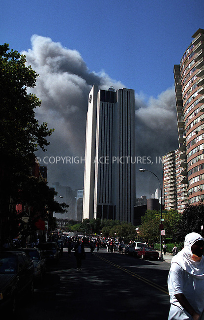 Picture shows Bell Atlantic (Verizon) building in downtown manhattan. In the background are thick clouds of smoke coming out from the area where the Twin Towers of the World Trade Center once stood. New York. September 11, 2001. Please byline: Alecsey Boldeskul/NY Photo Press.   ..*PAY-PER-USE*      ....NY Photo Press:  ..phone (646) 267-6913;   ..e-mail: info@nyphotopress.com