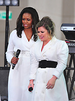 NEW YORK, NY - OCTOBER 11:  Michelle Obama and Kelly Clarkson on NBC's Today promoting and celebrating International Day of the Girl in New York City on October 11, 2018. Credit: John Palmer/MediaPunch