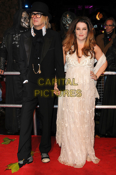 "MICHAEL LOCKWOOD & LISA MARIE PRESLEY .""Harry Potter And The Deathly Hallows: Part 1"" World Film Premiere, Empire cinema Leicester Square and Odeon Leicester Square, London, England, UK, 11th November 2010. .full length cream white lace long maxi dress holding hands wrap shawl halterneck black suit hat glasses jacket trousers .CAP/CAS.©Bob Cass/Capital Pictures."